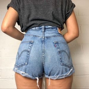 Vintage Levi's 569 high waisted distressed shorts